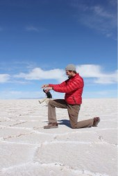 Isaiah Bouncing Wee Marvin on his Knee at Uyuni Salt Flats