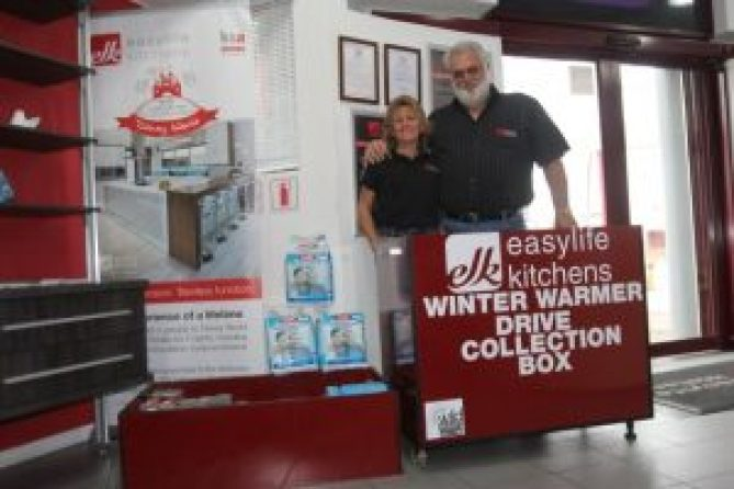 CARING HEARTS: Heidi Borges, left, and her husband Joe, are collecting warm clothes, blankets, food and toiletries for the elderly. Donations can be dropped off at Easy Life Kitchens or at Wild Coast FM Picture: QHAMANI LINGANI