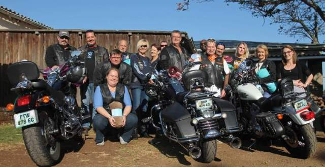 HARLEY HELPERS: The Steelwings Harley Davidson Club of East London has donated blankets, food and toiletries to the East London Child and Youth Care Centre . Pictured are the team with some of their bikes and social worker Larne Robus on the far right Picture: SARAH KINGON