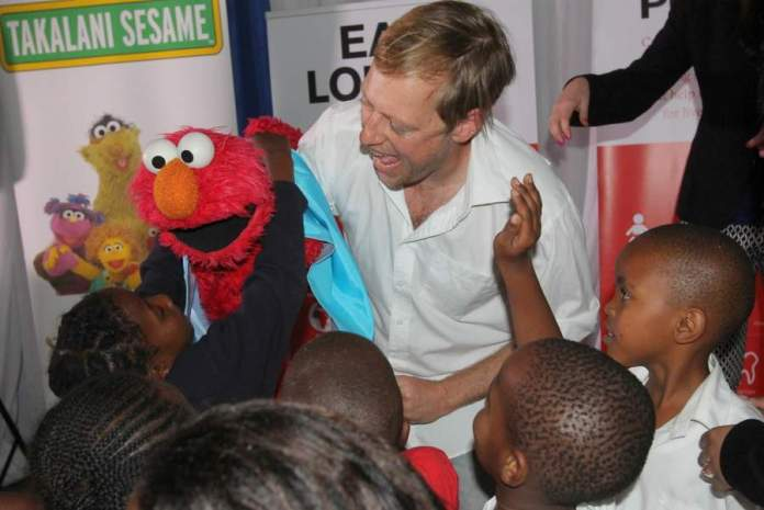 PLAY AND LEARN: Children from Hope School interact with ' Takalani   Sesame ' muppet Neno, operated by Damon Berry at the launch of new multimedia resources for children and their caregivers focusing on health, hygiene and nutrition Picture: SARAH KINGON
