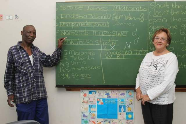 VOLUNTEER TEACHERS: James Matambo and  Hester   Browne  run a night school teaching basic English reading, writing and speaking and maths to those who did not have the opportunity to complete their schooling Picture: SARAH KINGON