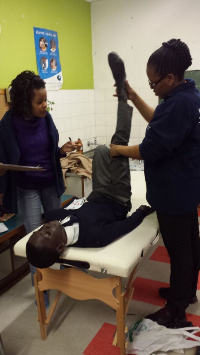 MEDICAL ATTENTION: Volunteer medical staff assist a pupil with the Healthy Athlete Screening project run by Special Olympics South Africa at Khayalethu Special School in East London at the weekend Picture: SUPPLIED