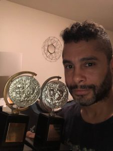 Wilson Jermaine Heredia in front of his two Tony awards