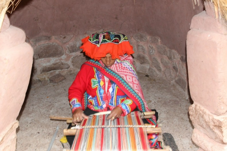 A native women weaving in the Sacred Valley, Peru