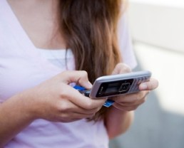 teenage girl texting on cellphone