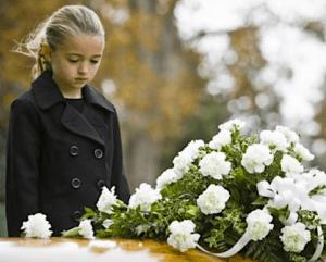 girl-attending-funeral-flowers