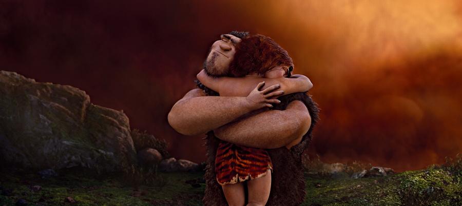Grug (Nicolas Cage) hugs daughter Eep (Emma Stone) in The Croods