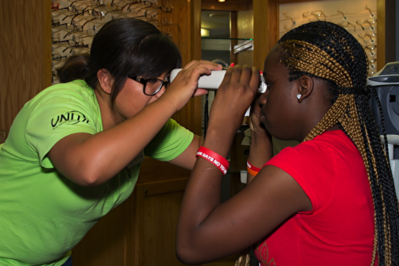 vsp vision care employee tests a girl's eyesight, chester pa