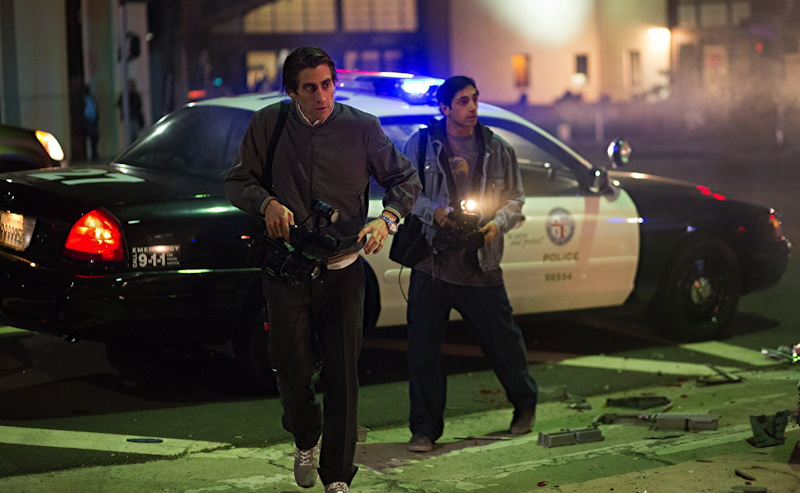 """Lou (Gyllenhaal) and Rick (Riz Ahmed) on the scene, from the film """"Nightcrawler""""."""