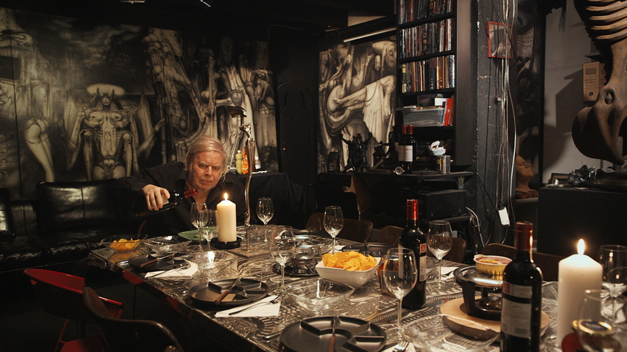 """The artist Hans Giger surrounded by some of his surreal artwork, from """"Dark Star: H. R. Giger's World"""""""