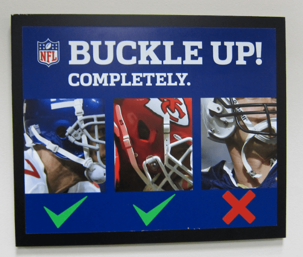 buckle up your helmet completely nfl signage