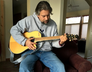 music, musical instruments, playing instruments = integral to life. dave taylor playing guitar