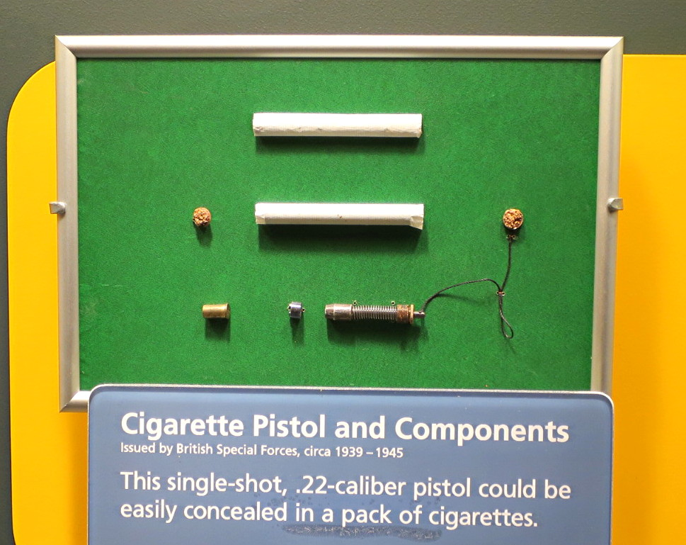 cigarette gun with bullet, cold war spy espionage