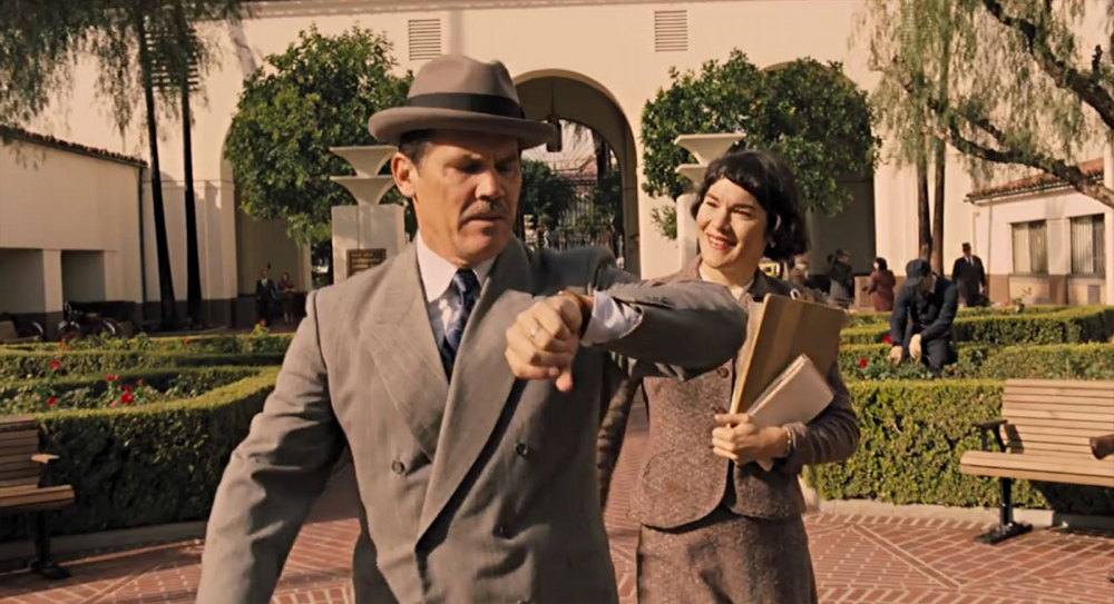 "Boss XX (Josh Brolin) and secretary Y (x), from ""Hail, Caesar!"""