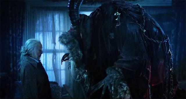 """Omi () stares down the Krampus, from """"Krampus"""" movie photo publicity still"""