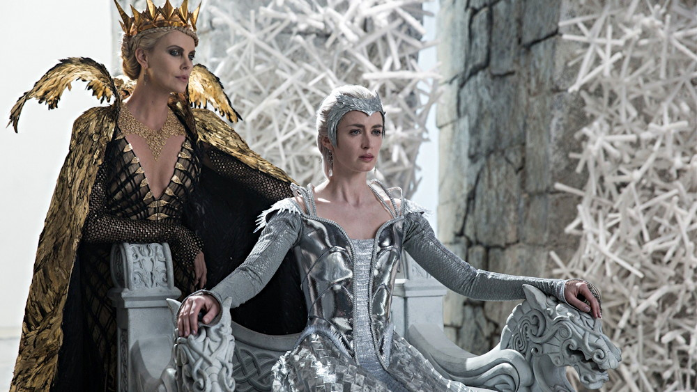 "Ravenna (Charlize Theron) looks down at Freya (Emily Blunt), from ""The Huntsman: Winter's War"""