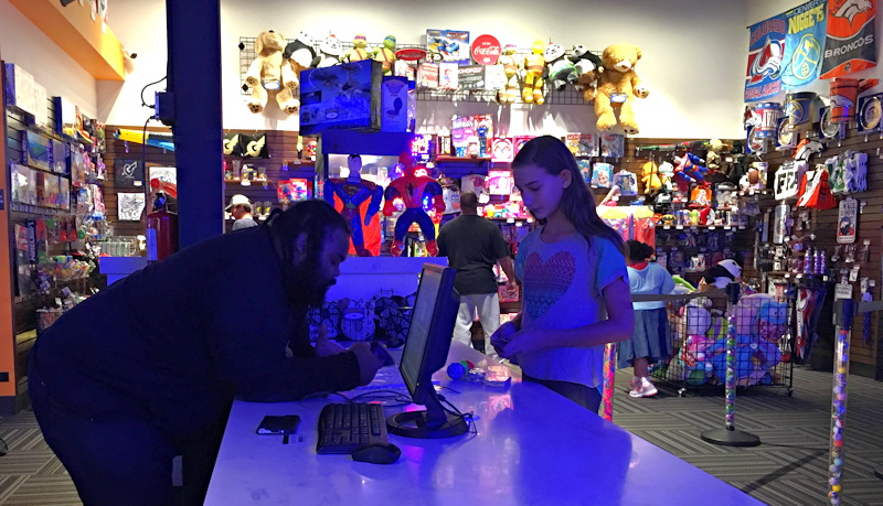 girl cashing in tickets for prizes, gameworks northfield