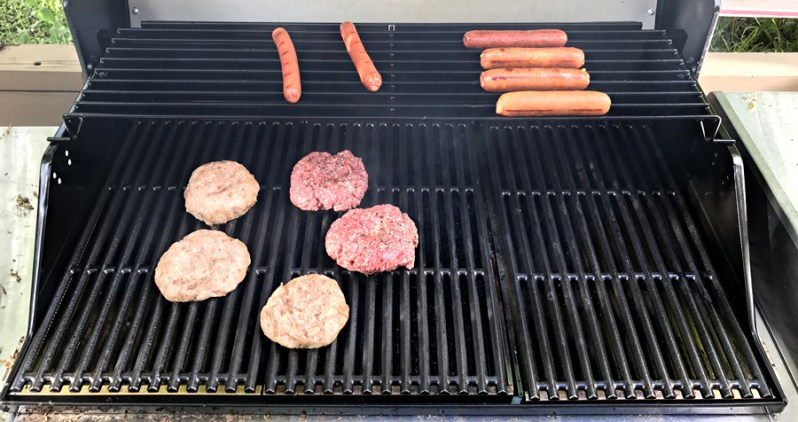 bbq grill with hot dogs, brats and burgers