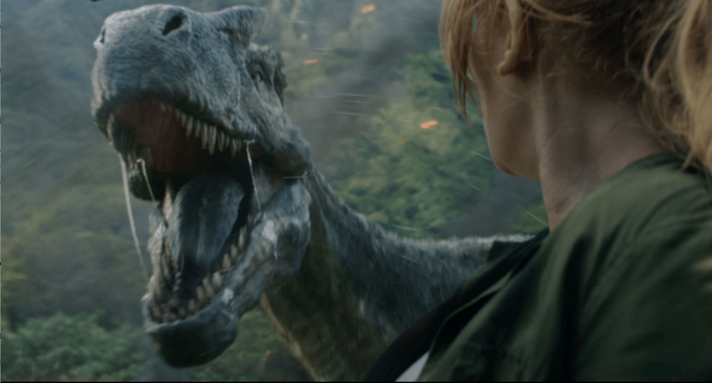 "Claire Dearing (Bryce Dallas Howard) gets up close and personal with a T-Rex, from ""Jurassic World: Fallen Kingdom"""