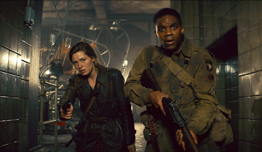 "Chloe (Mathilde Ollivier) and Boyce (Jovan Adepo), from ""Overlord"""