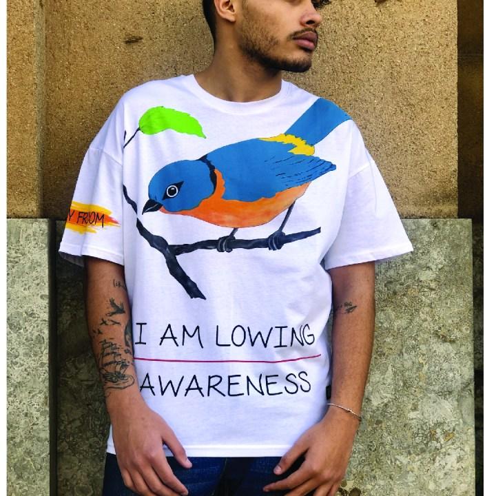 Maglietta con stampa uccello .