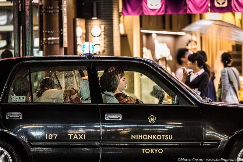 Geisha riding a taxi