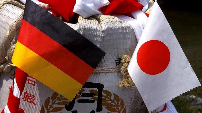 Deutsche und japanische Flagge