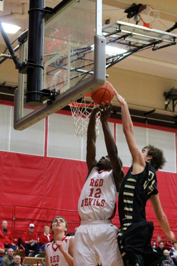 Dawson County High School Boys Basketball Stefan Stubbs Blocked Jan. 23, 2015. Copyright Go Gonzo Journal.