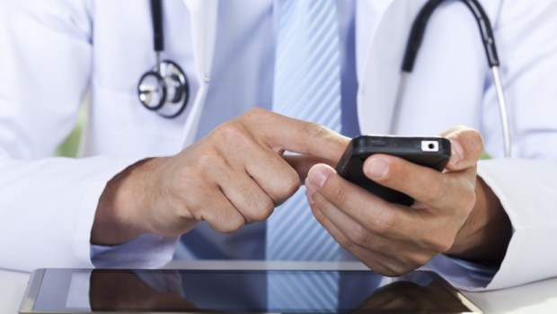 Physician Using Smartphone for Healthcare