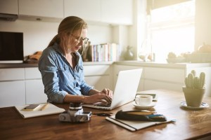 woman on laptop in kitchen
