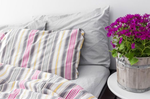 Make your homecare bedroom settings look as natural as possible. Add a comforter and pillows, so customers can envision their rest.