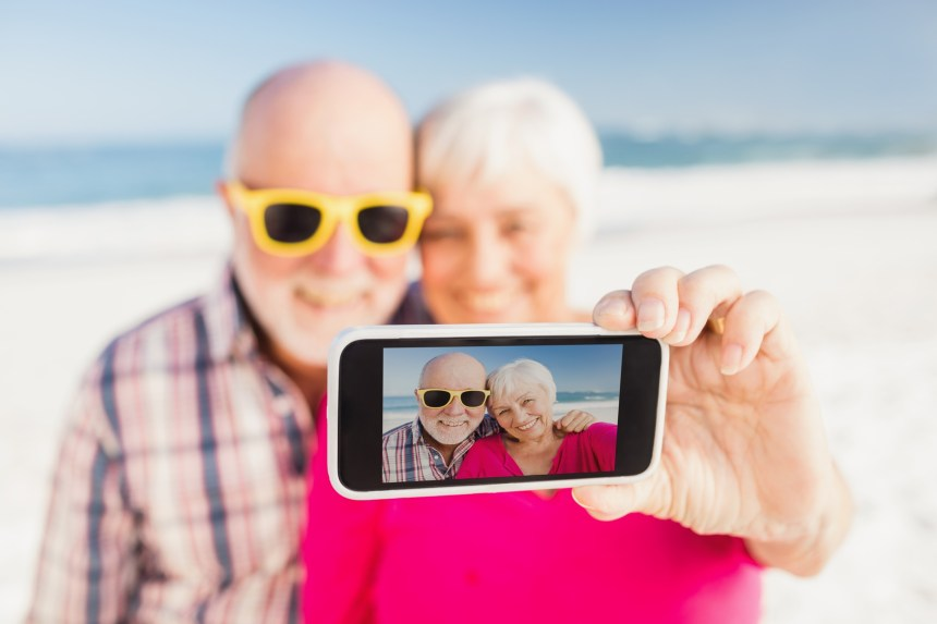 Senior couple taking selfie