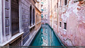 Colorful side canal in Venice