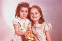 With baby-sister, aged 2