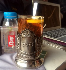 Tea is served old-school style, in aluminum glass-holders, or podstakanniki.