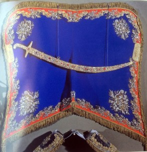 A horse blanket. The gold bits? That's gold thread. But the white & silver bits? That's all diamonds!