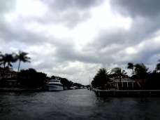 Boats parked next to the homes on the smaller, side canals of Ft Lauderdale