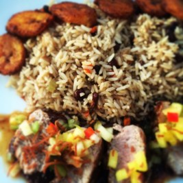 Jerk Rubbed Pork Tenderloin with roasted sweet plantains, pineapple-tomatillo salsa, coconut rice and jerk BBQ sauce