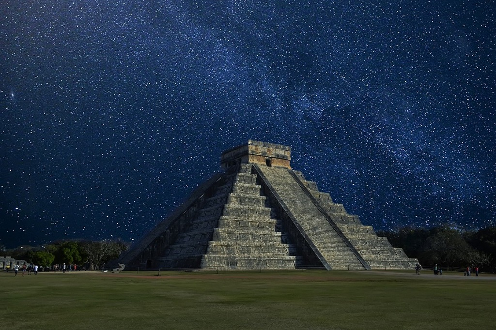 Chichen Itza Mexico, at night, lit against the Milky Way