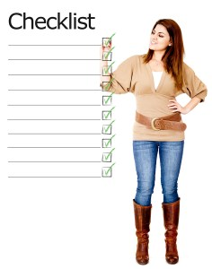 bigstock-Woman-ticking-on-a-checklist-32863340