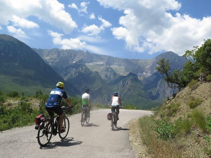 BikeTours.com President Jim Johnson (left) and Junid (middle) riding e-bikes on the mountain roads of Albania © 2016 Karen Rubin/gongplacesfarandnear.com