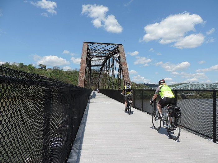 Riding over one of the rail bridges converted for biking use on the Great Allegheny Passage © 2016 Karen Rubin/goingplacesfarandnear.com