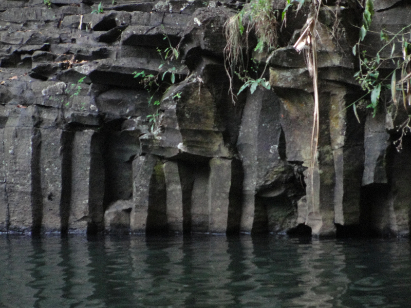 Rocks gracefully extending into the waterfall pool