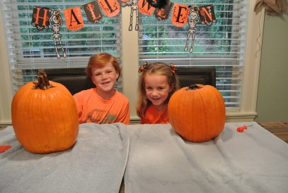 Happy kids with their whole pumpkins. Pre-carving.