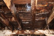 View of rotted floor from below