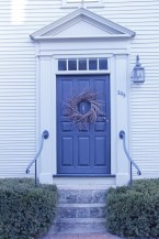 6-panel door. I love the primitive wreath and the handle in the middle.