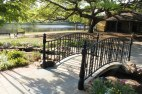 Wrought iron footbridge, Cane River Lake, and the Roque House