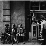 People sitting talking beside a coffee bar in a Beyoglu arcade-1958.