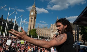 Russell Brand told the marchers there will be a 'peaceful, effortless, joyful revolution' against austerity in the UK. Photograph: Rex Features