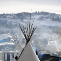 CANNON BALL, NORTH DAKOTA - DECEMBER 3: Fires create early morning smoke at Oceti Sakowin Camp on the edge of the Standing Rock Sioux Reservation on December 3, 2016 outside Cannon Ball, North Dakota. Native Americans and activists from around the country have been gathering at the camp for several months trying to halt the construction of the Dakota Access Pipeline. The proposed 1,172-mile-long pipeline would transport oil from the North Dakota Bakken region through South Dakota, Iowa and into Illinois. on December 1, 2016 in Cannon Ball North Dakota, Colorado. (Photo by Helen H. Richardson/The Denver Post)